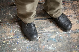 Feet and stains in the floor Henri Castella's workroom in Lyon, Fance. French painter.