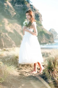 Bare feet bride with short dress, make up by Hannah Scarr, dress Alma J. Piha beach, Auckland, NZ.