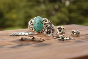 Silver jewelry setting down on a wooden table