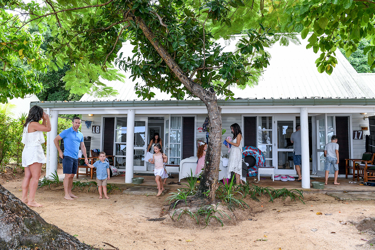 The extended family outside a villa in Malolo Island Resort Fiji, Family at a villa