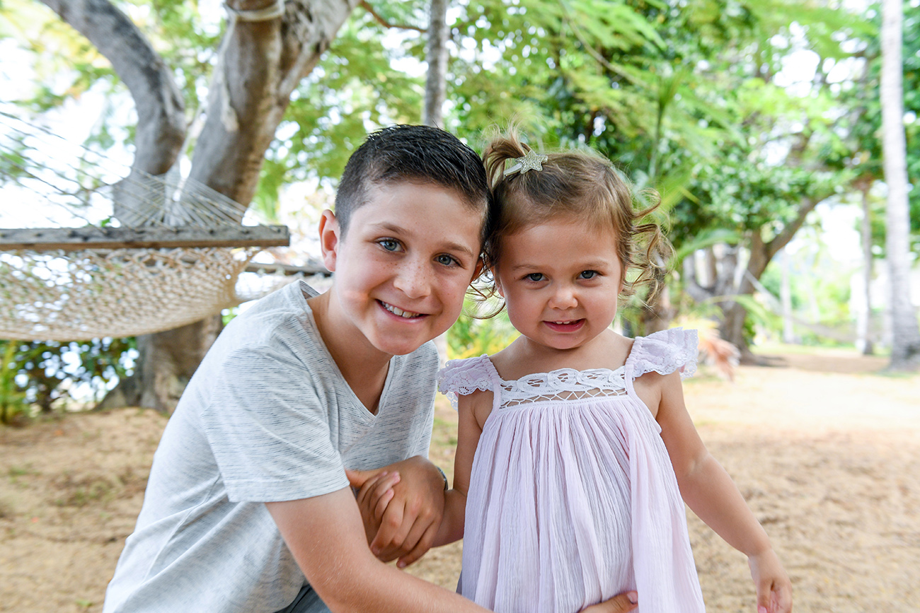 Cute brother and sister posing for the camera at villa in Malolo Island Resort Fiji