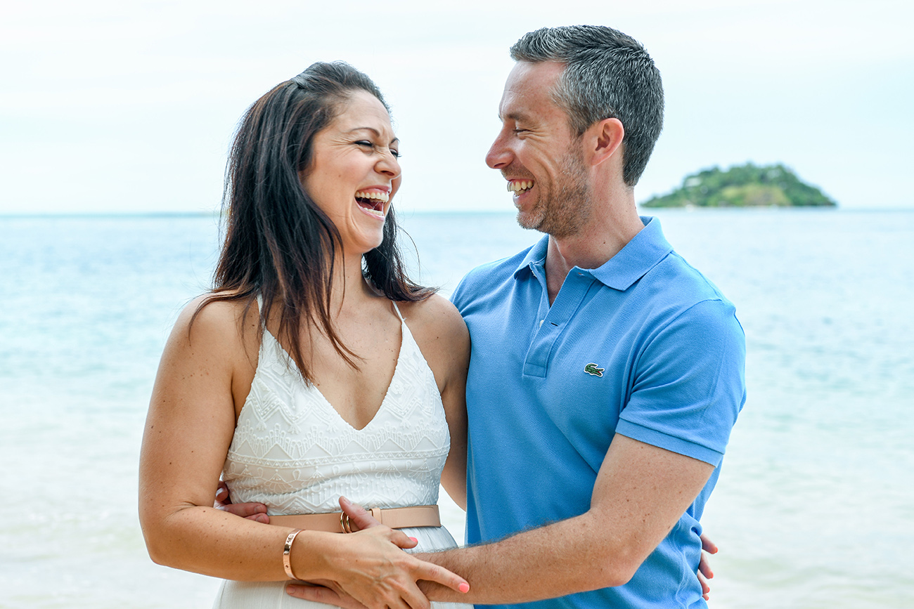 Husband and wife laugh at the beach in Malolo Island Resort Fiji