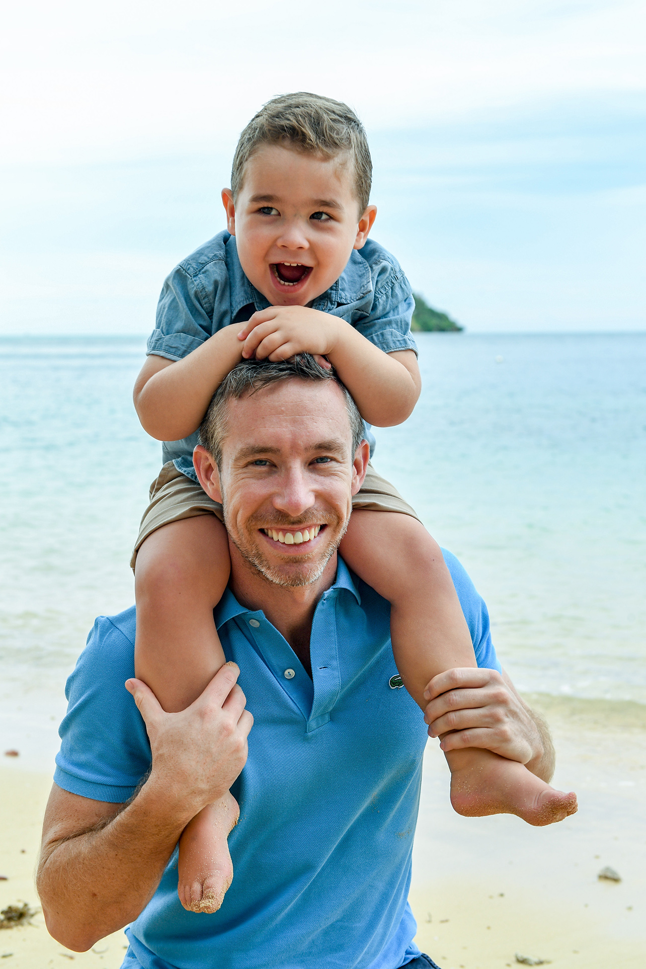 Father carries son on head at the beach in their family photoshoot in Malolo Island Resort Fiji