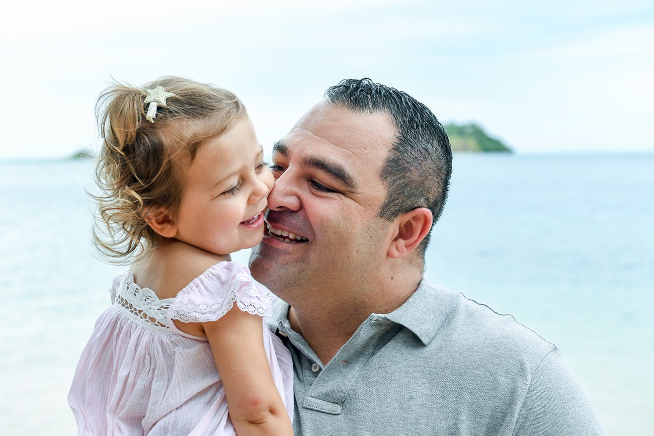 Father kisses daughter in family photoshoot Malolo Island Resort Fiji