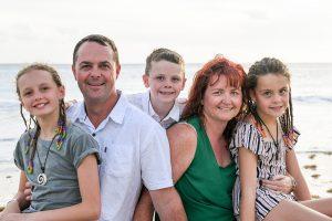 Closeup of mum, dad and children in beach family photoshoot Fiji