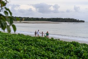 Wideshot of family walking on the beach in Fiji photoshoot
