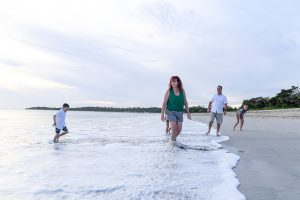 Family stroll in the ocean in Natadola Fiji in family photoshoot