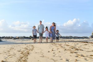Wideshot of family on Fiji beach in family photoshoot