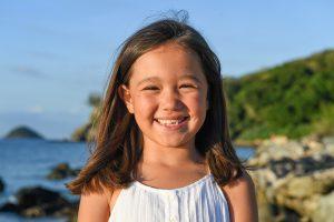 Stunning smile by cute brunette girl in family photoshoot Fiji