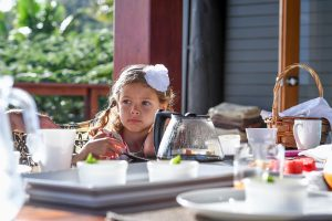 Stunning Polynesian girl at breakfast table