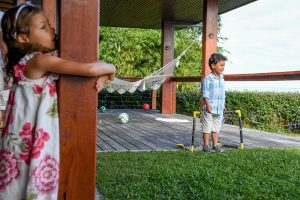 Polynesian boy plays soccer on the lawn in Fiji family vacation