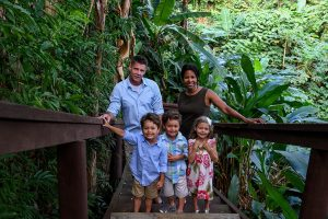 Polynesian Caucasian mixed race family pose for a picture in Fiji tropical rainforest