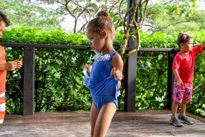 Cute little princess pulls her dress up