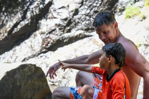 Dad and son bond on the rocks in Fiji