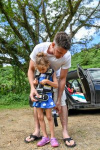 Dad puts carseat on daughter in Fiji