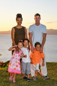 Family portrait against the ocean and sunset in Fiji family photoshoot