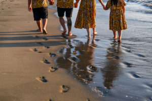 The family leaves footprints on the beach at Double Tree Hilton Fiji