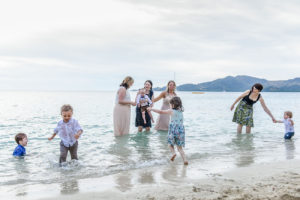 Family play in the ocean at the shores of the Fiji Plantation Island Resort