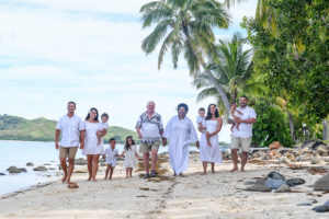 All white family portrait on the shores of Plantation Island Resort Fiji