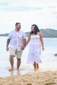 Polynesian couple strolling in the sea