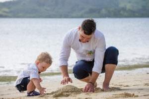 father and son build sand castles at Plantation Island in Fiji