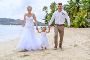 Mom dad and daughter all white photoshoot on the beach