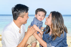 The cute little boy is given all the love by his parents at Plantation Island Resort Fiji