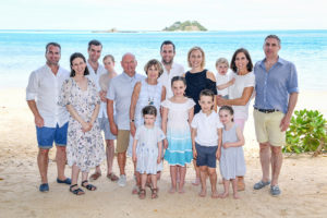 The entire extended family pose for a group family photo at Malolo Island Resort