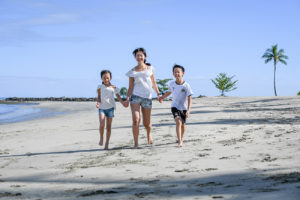 Cute asian family on the beach at Natadola Fiji