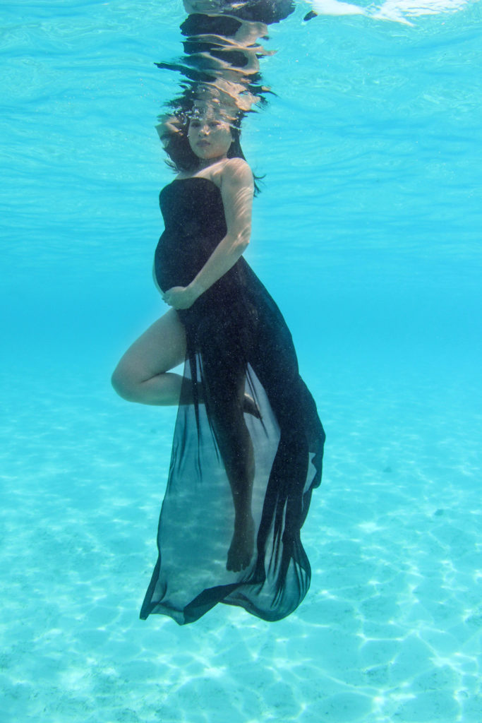Stunning pregnant, all black, underwater portrait