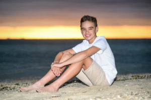 Portrait of a boy at sunset on the beach in Fiji