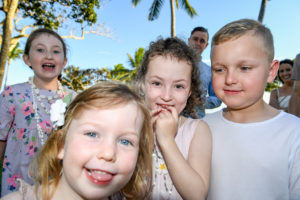 Group shot of cousins at the Shangri La in Fiji on the lawn