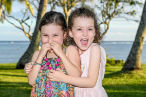 Sisters acting silly and hugging during the photo session in Fiji