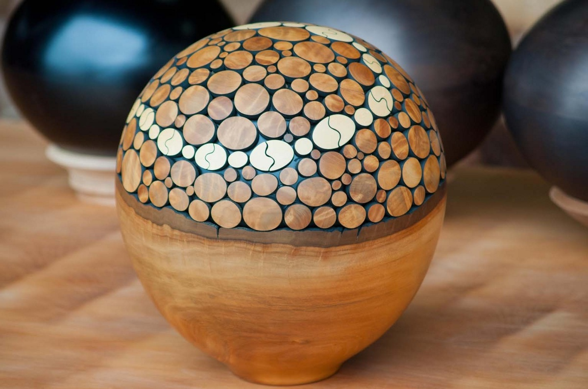Sphere sculpted on an ancient kauri tree wood sphere. Kauri Kingdom, Awanui, Northland, New Zealand.