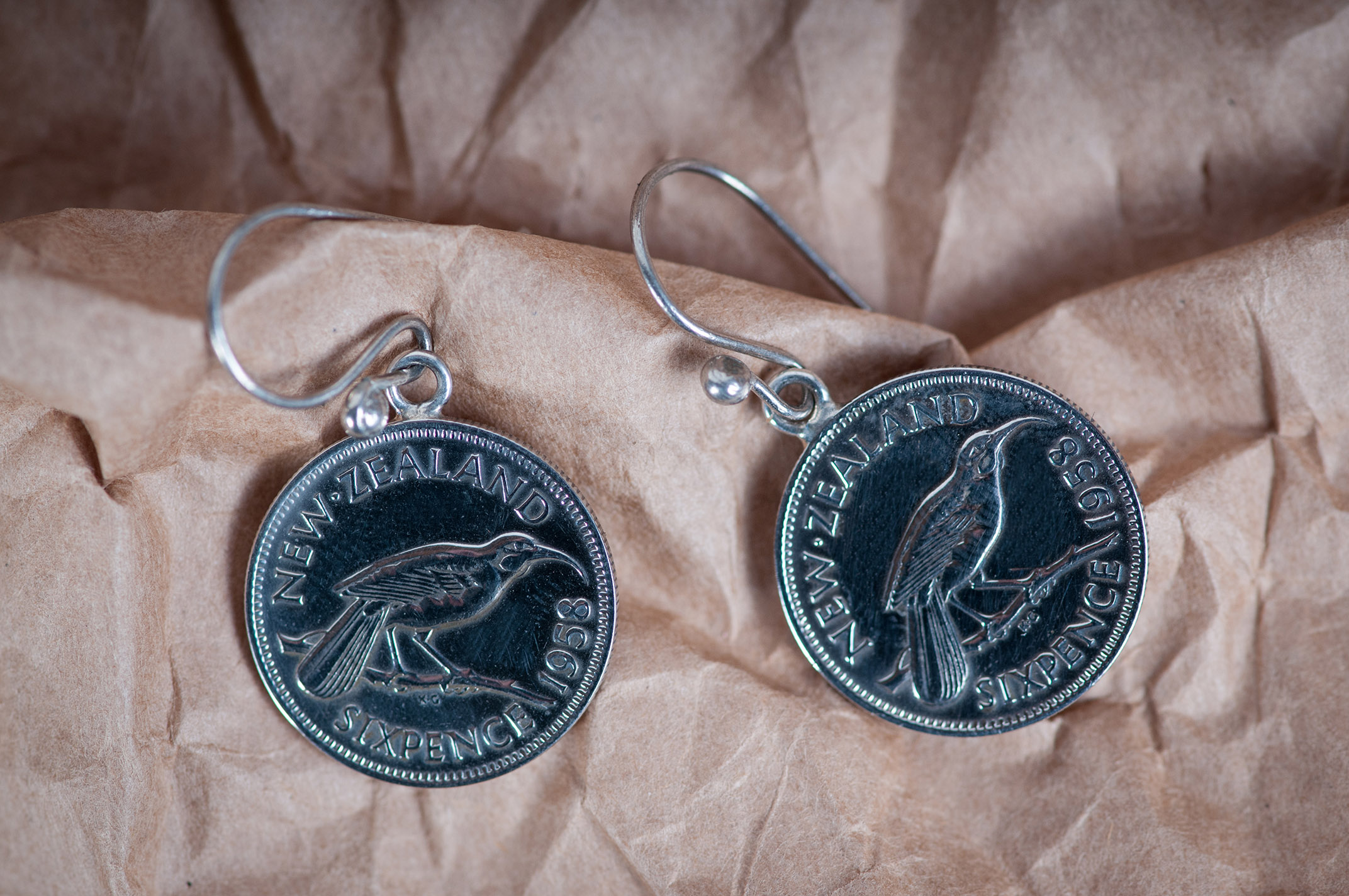 NZ Sixpence 1958 Earrings Product photography Anais Chaine professional Auckland photographer for Auckland museum www.anaischaine.com