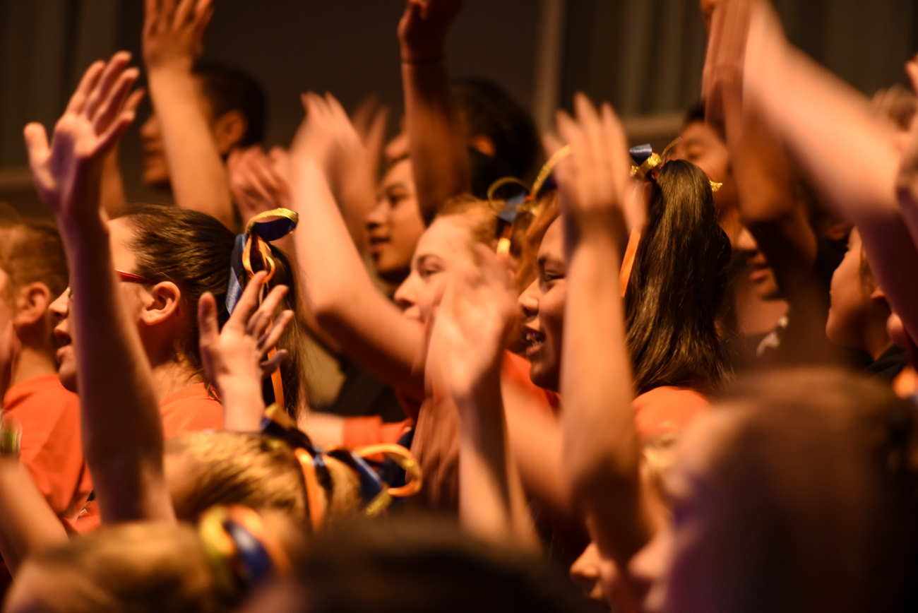 Close-up of the orange team singing Vodafone Event Centre Auckland