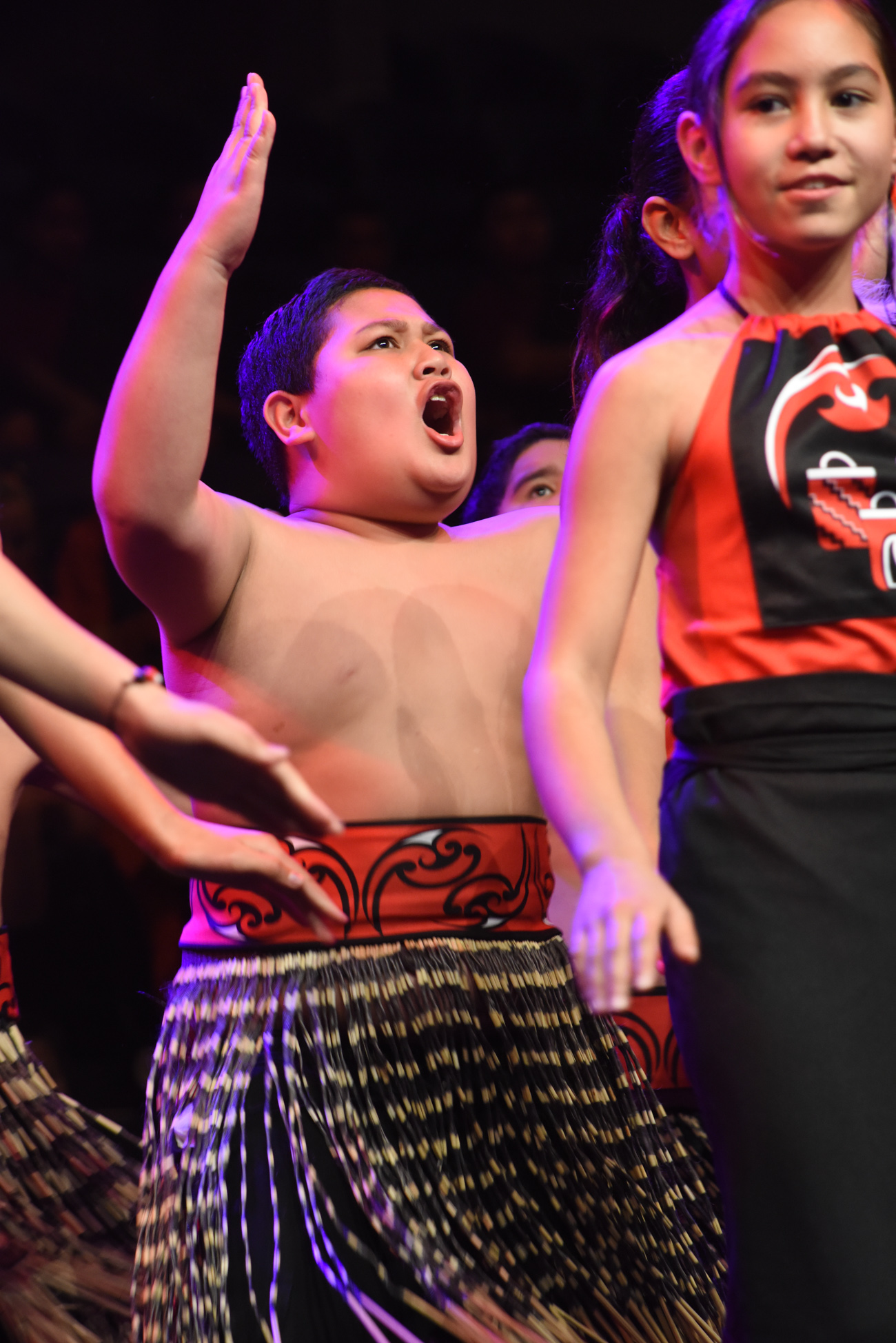 A little maori boy dancing his traditional dance intensely Vodafone Event Centre