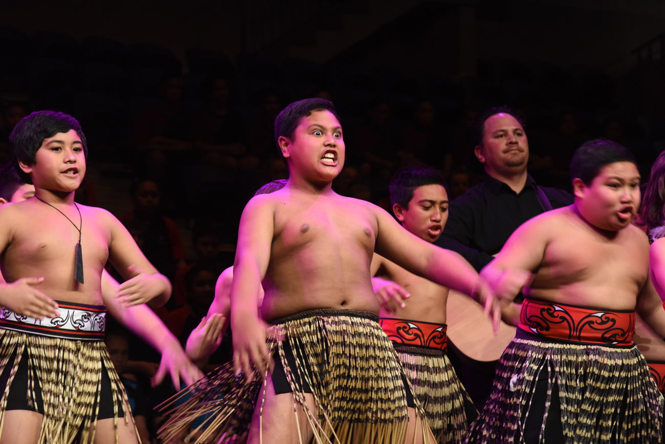 Maori boys dancing their traditional dance intensely