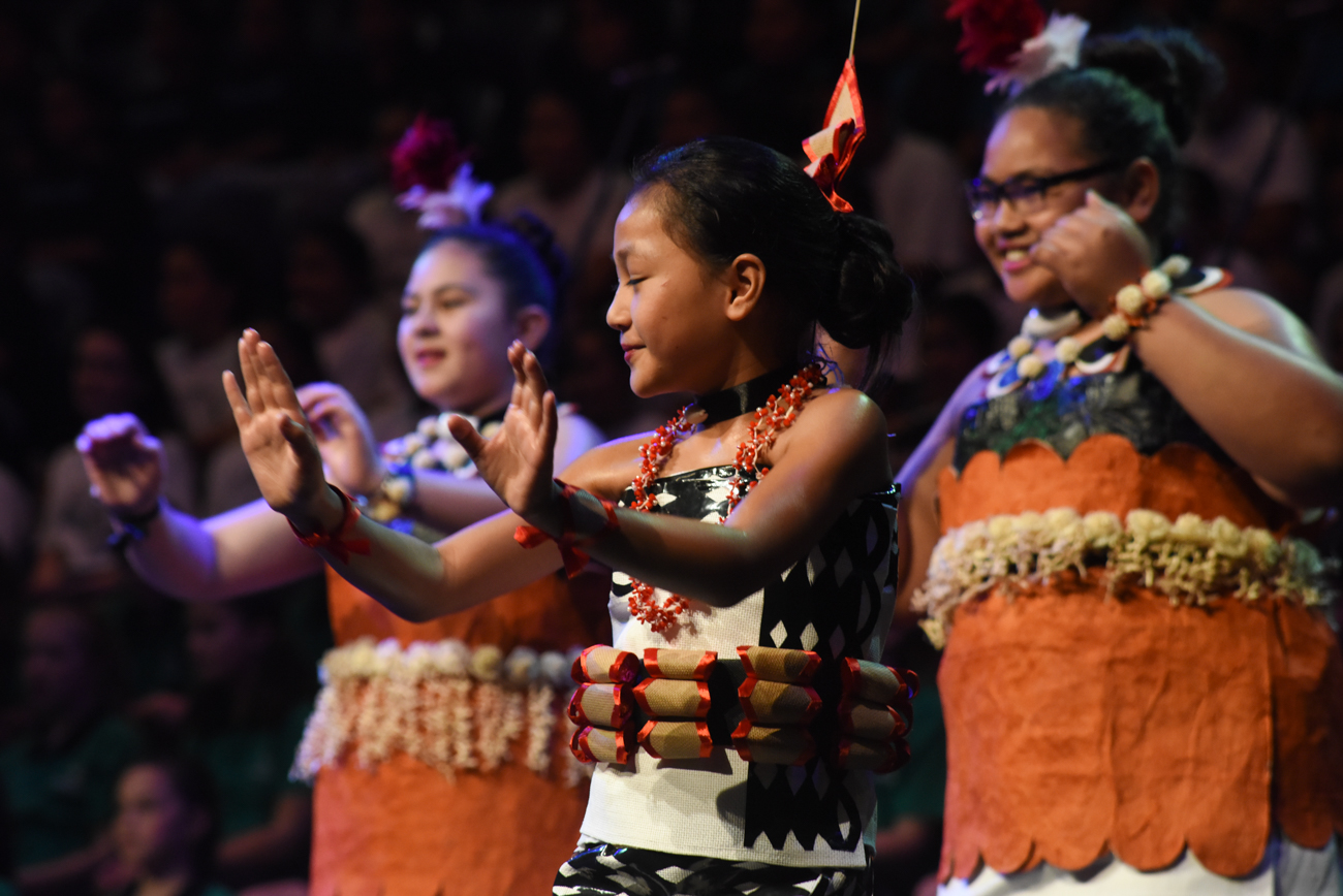 A young girl dancing proudly her traditional pacific island dance