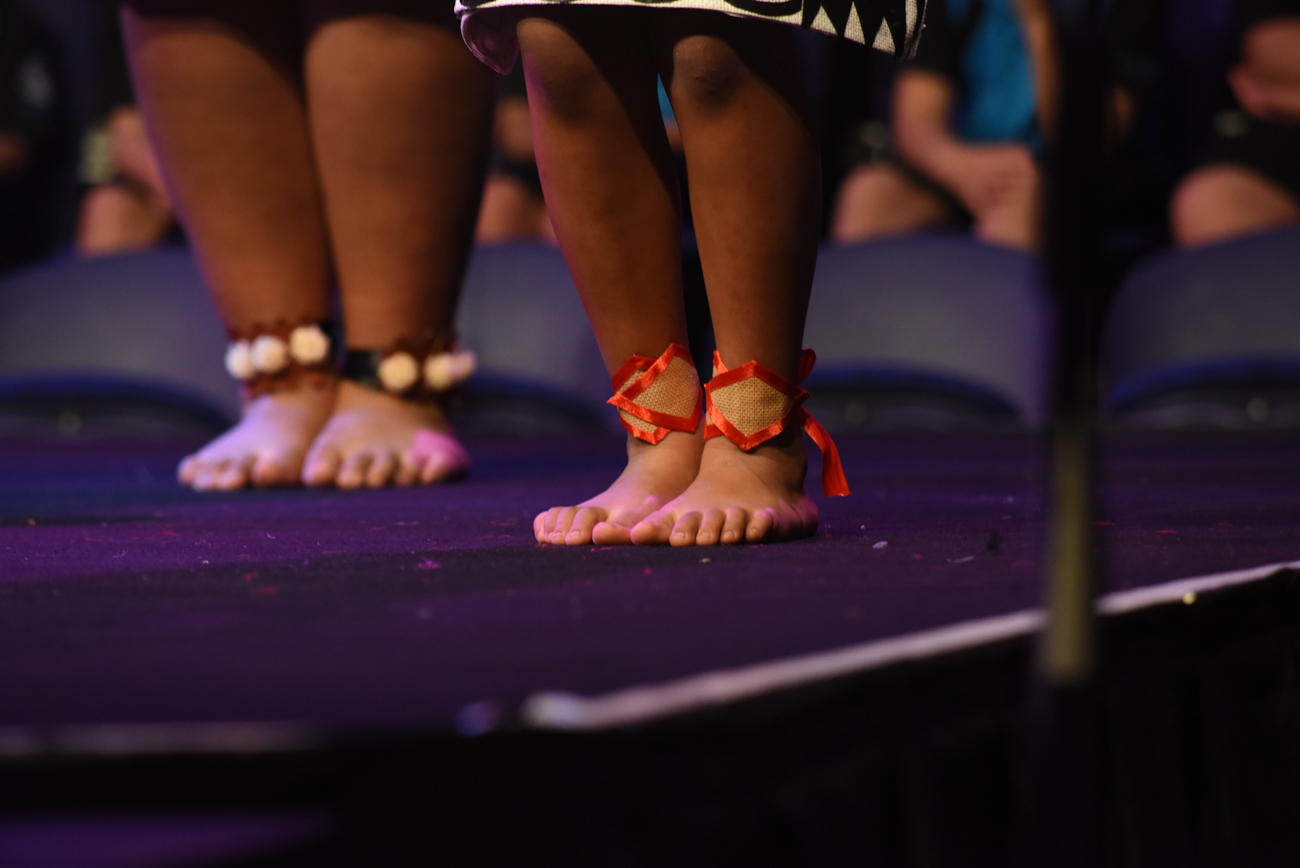 Close-up of dancers' feet with bracelet around her ankles