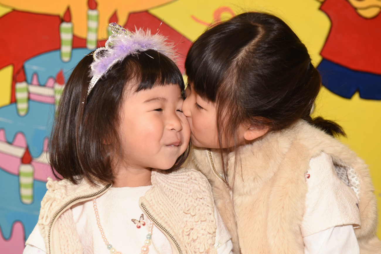 Sisters kissing eachothers