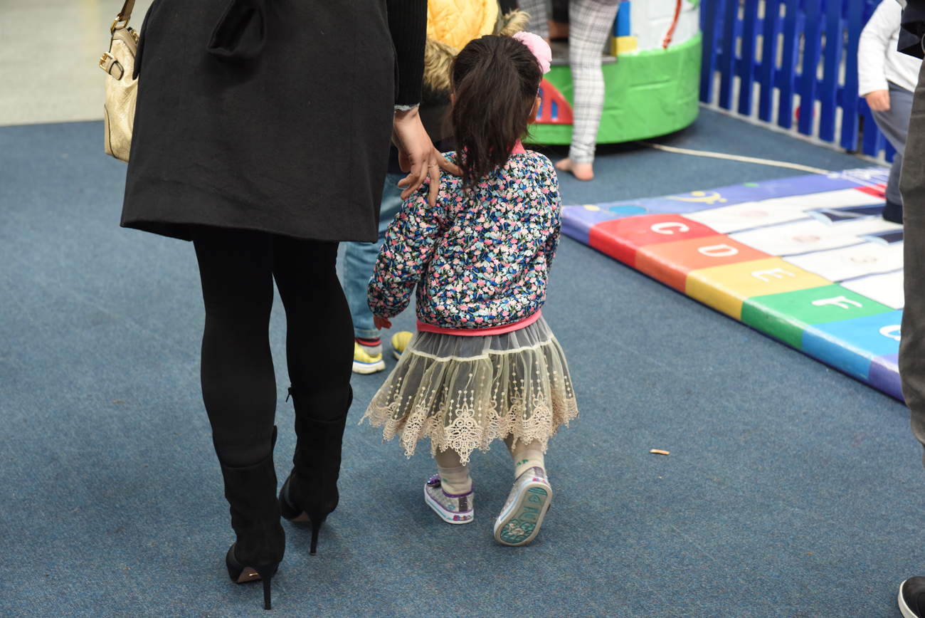 Young girl walking to the birthday room