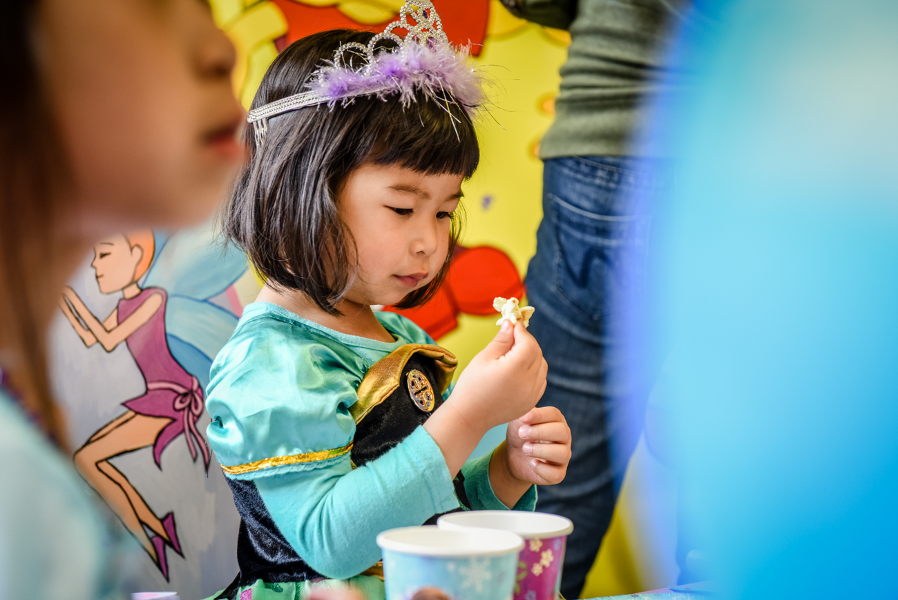 Birthday girl staring at a pop corn