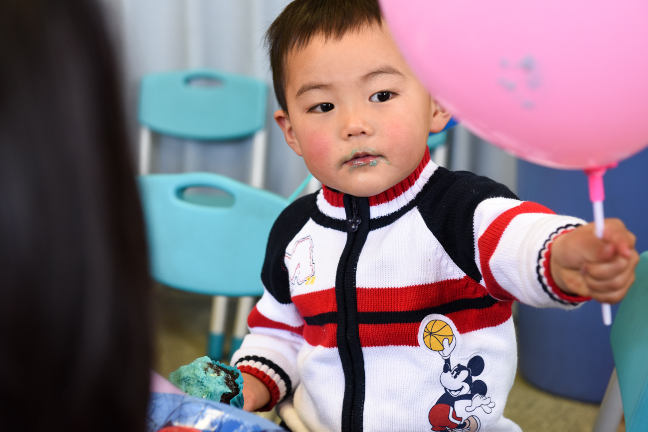 young chinese boy with blue lips
