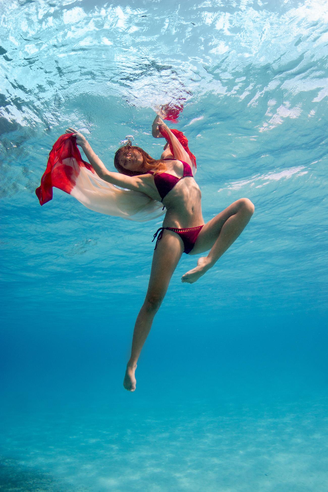 Model woman underwater in Fiji
