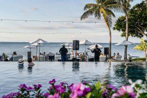 Swimming pool and palm trees at Waitui club