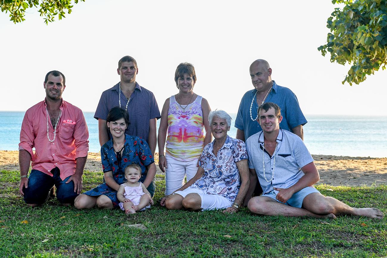 A family photoshoot of 3 generations on green coral coast Fiji