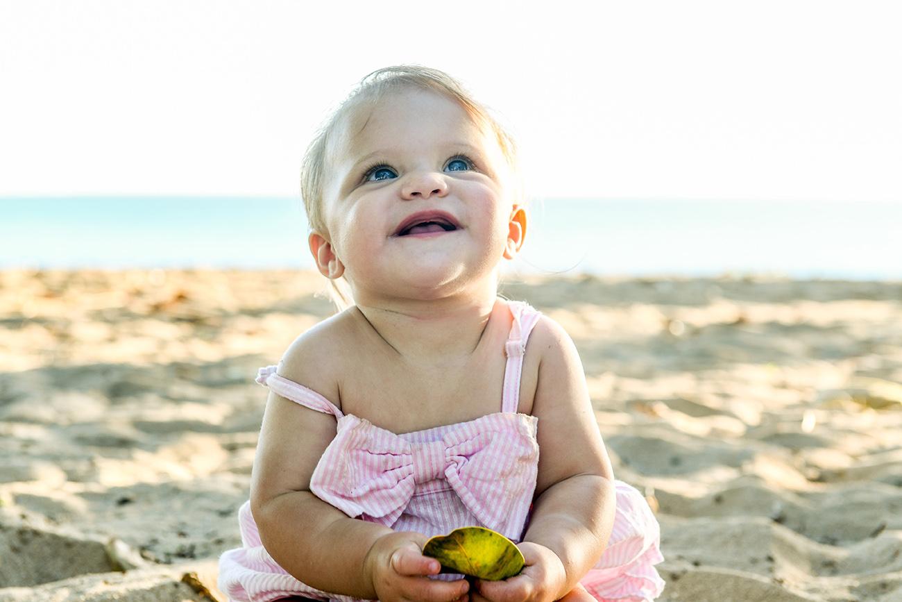 Cute baby portrait on sandy beach in Fiji family photoshoot