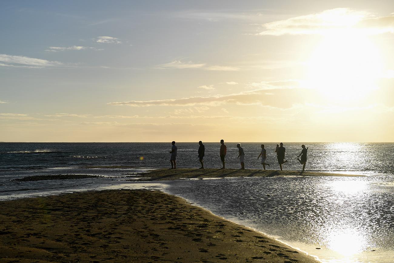 Creative Silhouette 3 generations of family in evolution of man photoshoot at Natadola Fiji