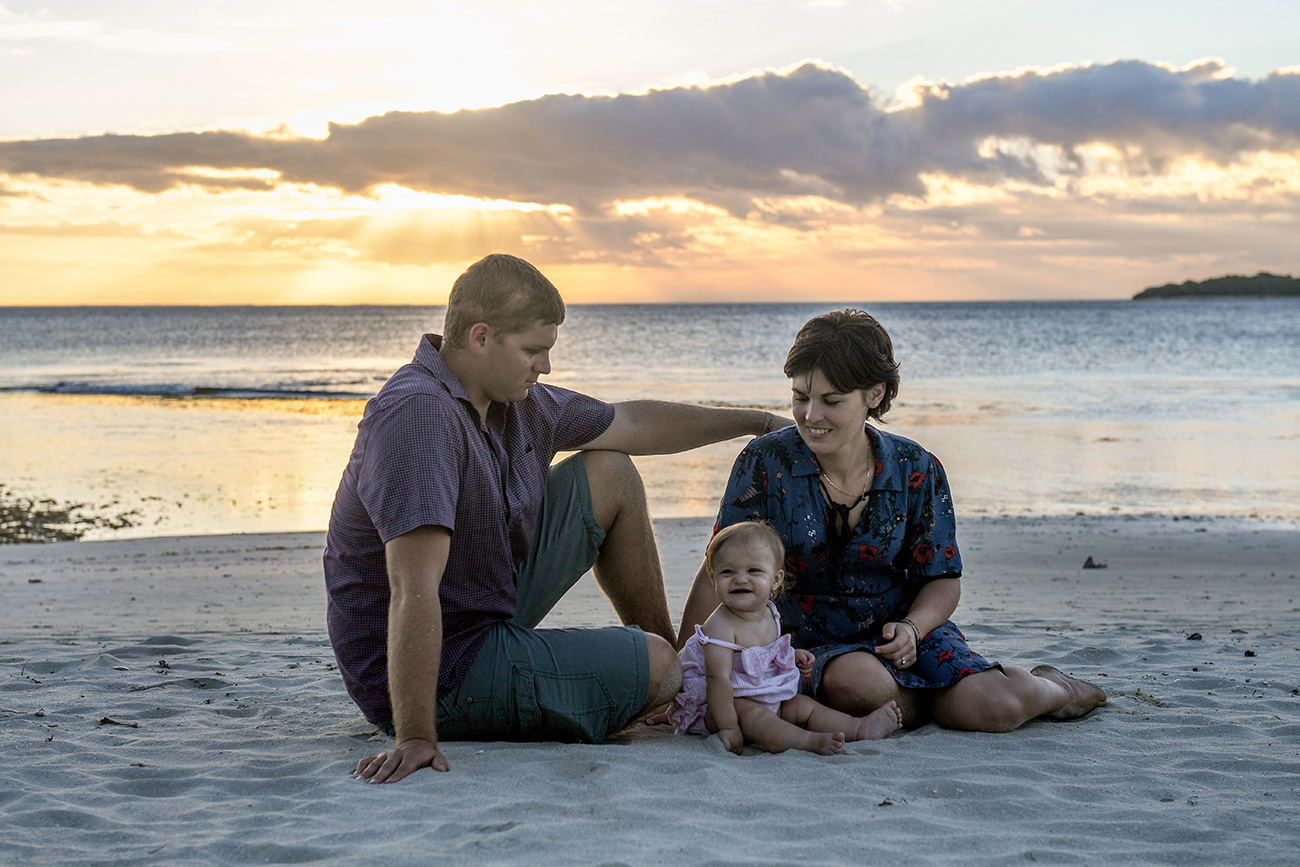 Mother father daughter in Family photoshoot at Natadola beach Fiji